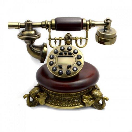 Telefon vintage decorat cu picioare sub forma unor elefanti